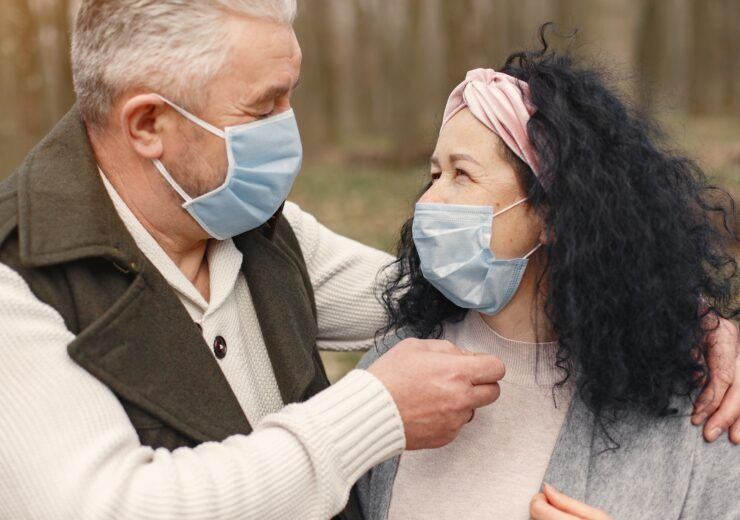 photo-of-man-and-woman-wearing-face-masks-4148971